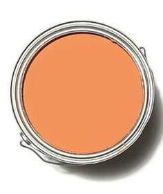 From show-stopping wall paint to earthy home accents, you can easily (and artfully) add orange to any room in the house.