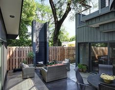 Exterior enclosed courtyard with customized wood burning fireplace tower, pigmented concrete patio
