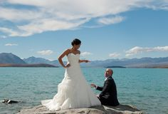 Who's boss now :-) bride and groom have fun after their wedding at Lake Tekapo New Zealand