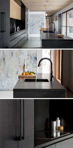 With the exception of the cabinets above the stove area, the entire modern kitchen is black, including the hardware, countertops, backsplash, and appliances.