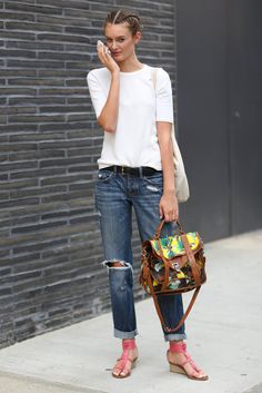 This Is It — A Look Back at the Year's Best Street Style : Sometimes, it's all about the accessories — with this white tee and distressed denim look, it's really all about the printed Proenza satchel and strappy sandals.