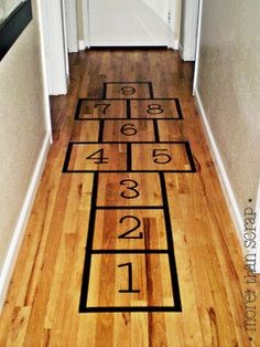 hopscotch - use blue painters tape so the floor doesn't get sticky & little beanbag stuffed animal.