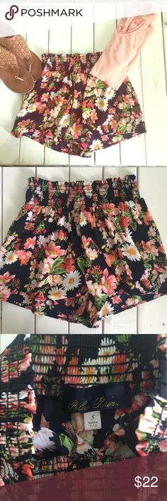 Navy floral shorts Beautiful floral shorts. Dark navy color with all over floral print. Elastic waist. Size small. Excellent condition. Francesca's Collections Shorts