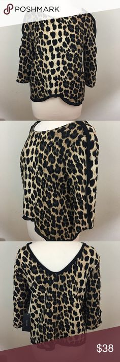 """Zara Animal Print Top Black and gold Animal Print Top has 3/4 length sleeves, a scoop neck and a """"V"""" neck back. A black ruffle runs the length of the sleeves and lines the"""" V"""" in the back. Measures 19"""" inches armpit and 23""""inches long. 100% polyester. Machine wash Zara Tops Blouses"""