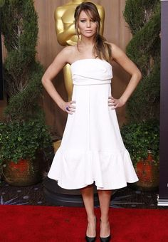 Latest Celebrities Fashion: Jennifer Lawrence wore a white tea dress for the occasion, and contouring nude make-up