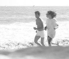 Madonna & Sean Penn jogging on the beach in Malibu right before their wedding on August 16, 1985