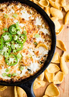 Hot and Bubbly Jalapeño Artichoke Dip with Corn Chips | DesignMom.com