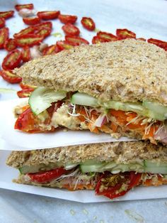 Slow-roasted Tomato, Cucumber, and Hummus Sandwich...well, I didn't slow rost the tomatos. But it was still good. Used a tomato flavored hummus from TJ's and Ezekiel Bread.