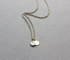 Delicate simple everyday mini mother of pearl & brass disc pendant gold necklace chain. $12.00, via Etsy.