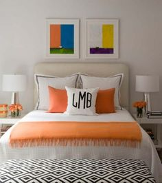 colorful guest room - love the orange throw + flowers