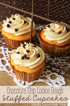 Chocolate Chip Cookie Dough Stuffed Cupcakes - Yellow cupcakes with chocolate chip cookie dough in the middle and topped with brown sugar frosting!