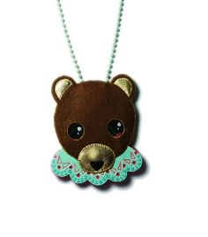 Suzie in a bear mask necklace