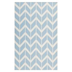 Anchor your living room seating group or define space in the den with this artfully handcrafted wool rug, showcasing a chevron-inspired motif for eye-catchin...
