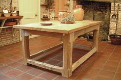 Oak dart stop chamfered table. Specially made for the National Trust for their Sutton House property in Hackney, London. The table is used in their Tudor kitchen for live demonstrations of food preparation and cooking during the 16th century.