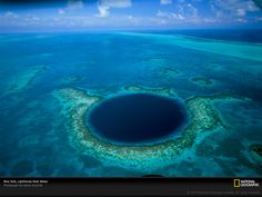Blue Hole, Light House Reef, Belize: More than 1000' in diameter and 400' deep, the hole is the opening of what was a dry cave system during the Ice Age and is now world renowned for its marine life.