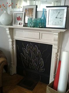I'd rather draw mine more realistically, but what a cute idea for a non-working fireplace!