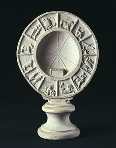 """Sundial. Cast from the original, ca. 1929 Rome, Museo della Civiltà Romana, inv. M.C.R. n. 2897. A band with the signs of the zodiac runs along the edge of the clock. Its inner surface is divided into 12 equal segments to determine the 12 hours of the day, by means of a """"style"""", according to the latitude and the given period of the year."""
