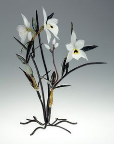 Dendrobium by Loy Allen Glass. American Made. See the artist's work at the 2014 Buyers Market of American Craft, Philadelphia, PA. January 18-21, 2014. americanmadeshow.com #Dendrobium, #flowers, #glasssculpture, #sculpture, #glass, #americanmade