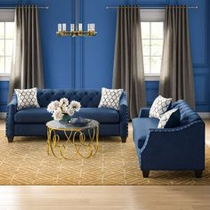 A glamorous living room begins with this Bostick 2 Piece Living Room Set. This Bostick 2 Piece Living Room Set features sloped arms enhanced with nailhead trim elements. Clear feet elevate the piece and continue the contemporary look. The luxuriously soft velvet upholstery surrounds high-density foam cushions for style and comfort. Upholstery Color: Blue | House of Hampton® Bostick 2 Piece Standard Living Room SetVelvet in Blue, Size 33.0 H x 86.0 W x 35.0 D in | Wayfair Blue And Gold Living Room, Navy Living Rooms, Blue Rooms, Living Room Colors, Home And Living, 3 Piece Living Room Set, Living Room Sets, Blue Wall Colors, Color Blue