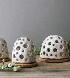 Waft some aromatic incense in the air with this handcrafted beehive shaped burner. The domed shape and bottom plate are both sculpted in gritty, sandy clay and the top is pockmarked with holes to allow the smoke to rise. The incense holder can also be paired with a small votive, for mood lighting.