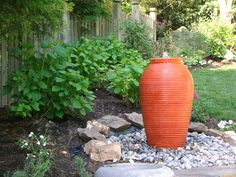 This colorful urn fountain anchors a corner of the yard. From 15 Unique Water Gardens