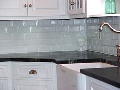 black granite with black subway tile with thick grout line in