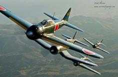 A flight of Japanese Zeros in flight.