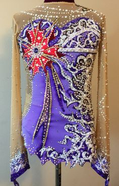 Contains pure Swarovski crystals and pearls. Generally fits girls ages 8-12  Measurements:  Girth- 45.5 Chest- 25 Waist- 20.5 Hips- 25.5 Arm- 20 Neck 12