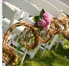 """Wicker fans rested on each chair for guests to keep cool during the ceremony. A birch tree """"rope"""" decorated with chiffon, ivy, and hydrangeas lined the aisle."""