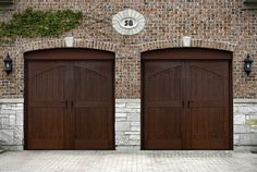 Ranch House Doors Elements Collection faux wood garage doors that looks just like real wood. Mahogany faux wood cladding with Clear Cypress overlays. Decorative Hardware: FH-510 Iron Door Handle with FH-517 Pyramid Clavos. www.faux-wood-garage-doors.com
