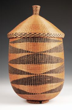 Rwanda | Large woven grass basket with an interior frame of split bamboo, by the Tutsi People.  Mid 20th Century