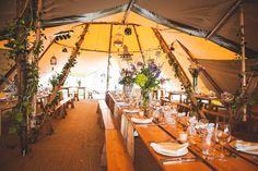 Tipi interior with rustic florals  #Tipi #TipiWedding #TipiParty