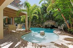 Gulf Breeze is a great Anna Maria Island vacation rental for a family style Tiki party! Enjoy the heated pool with swim up Tiki along with a great outdoor bar area! Book your stay at Gulf Breeze today with IslandReal.com!