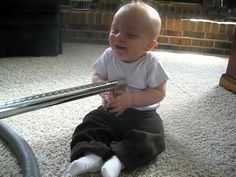 Baby can't stop laughing at vacuum!