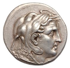 Macedonian etradrachma showing the head of Alexander the Great, with the ram's horn and clad in an elephant skin and aegis. This is one of the earliest coin portraits of Alexander around  318 BC Silver