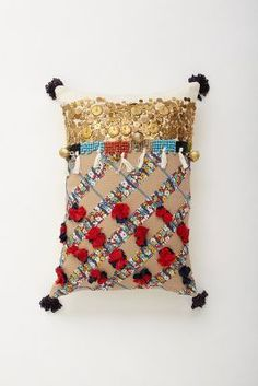 Toss this playful pillow on a couch or a chair to add character to any space. #Anthropologie #PinToWin