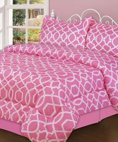 Brighten bedroom décor with a splash of fabulous fashion. Stylishly sophisticated, this comforter set offers a wildly chic way to personalize a bed in need of a fresh makeover.