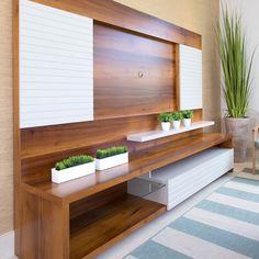 Para un living room contemporáneo este hermoso centro de entretenimiento en madera con color off white