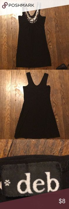 Black top with shimmer, Sz S. Brand Deb. Very good condition. Great for bringing some shimmer but, still classy. Deb Tops