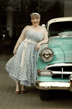 1950s style polka dot wedding dress and vintage car