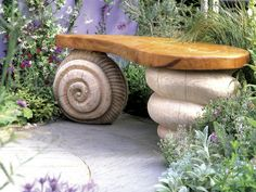 "This whimsical garden bench features a simple wooden seat and uses snail shell and sea shell designs as ""legs. Big Backyard, Backyard Landscaping, Landscaping Ideas, Amazing Gardens, Beautiful Gardens, Concrete Garden Bench, Landscape Design, Garden Design, Architecture Design"