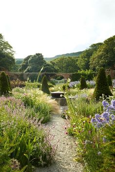 Lay a Gravel Path  in Country Garden Design Ideas - how to a create a well-planned herbaceous border and farmhouse or cottage look, ideas for gardens both big and small.