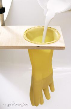 ~ DIY Jewelry Holder ~  We need: - 1 kg of plaster - Thick rubber gloves - Wood Size 20 x 30 cm - Containers for constitution plaster - pencil - A tool to cut hole in wood - Cup same size as the wrist opening of gloves.  1. Use cup as pattern and trace a circle for the opening in your wood. 2. Cut your opening and sand the edges smooth. 3. Secure the glove into the opening. (Glue, fasten down). 4. Mix plaster in your container according to pkg directions. 5. Pour plaster into