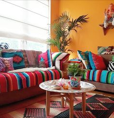 I love this room, and what a colorful solution if your sofa has seen better days.