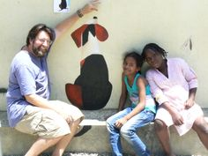 Work on the school mural with Mary and Iesa.