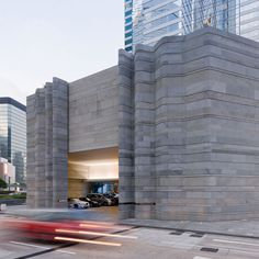 Waves of stone ripple around the corners of a Hong Kong shopping centre that was recently renovated by British designer Thomas Heatherwick.