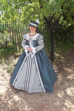 Blue Elizabethan period gown with Italian influences.