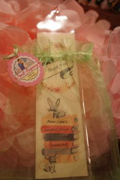 Book themed baby shower with book marks as favors