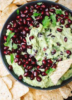 Homemade pomegranate guacamole recipeFestive pomegranate guacamole, perfect for holiday parties or as a snack! - cookieandkate.com