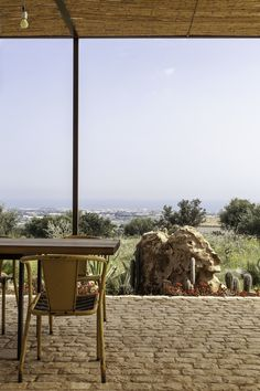 Admiring uninterrupted views over a peaceful Sicilian countryside towards the sea, at Baglio dei Carrubi   The Thinking Traveller Photography by Chiara Cochi